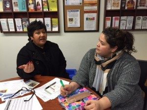 Esther Rosario, an independent consultant for the Orland schools,, discusses the immigration fair with Neli Peña of Orland Unified.