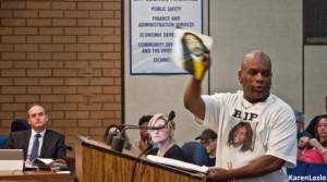 photo by Karen LasloDave Phillips waved a picture of his son, the late Desmond Phillips, while speaking to the Chico City Council at its April 5 meeting.